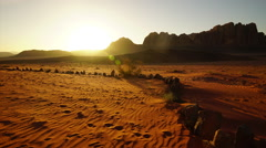 Time lapse of beautiful sunset in barren desert Stock Footage