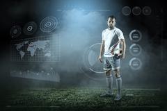 Soccer player with ball in action outdoors Stock Photos