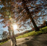Angled view of cyclist cycling in sunlight Stock Photos
