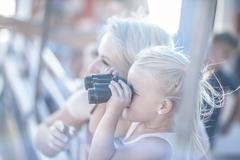 Cute girl looking through binoculars on tourist boat trip, Cape Town, South Kuvituskuvat