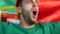 Portuguese Guy Celebrating in Flag - in Slow Motion Stock Footage