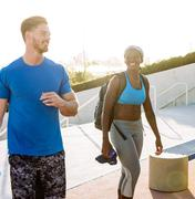 Man and woman training, chatting at sport facility, downtown San Diego, - stock photo