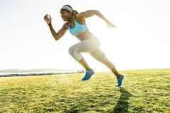 Young woman training, sprinting at coast, downtown San Diego, California, USA Stock Photos