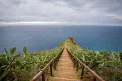 Wooden steps path from Cristo Rei statue to the ocean cape Stock Photos