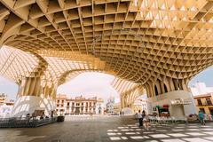 Metropol Parasol is a wooden structure located Plaza de la Encarnacion square - stock photo