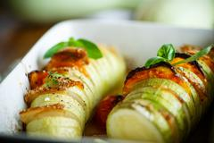 Baked zucchini stuffed with vegetables Stock Photos