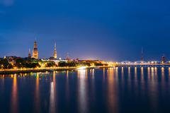 Cityscape At Evening Of Riga, Latvia. Night View With Blue Sky Stock Photos