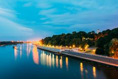 Scenic Evening View Of Sozh River, Illuminated Embankment, Park Stock Photos