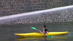 A yellow kayaker overtaking another one Stock Footage