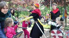 Children Beating Actors in Medieval Costumes by their Foam Swords Stock Footage