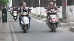 China people on motorbikes Stock Footage