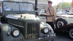 Man Wearing in Soviet Military Police Uniform Guarding Retro Vehicles Stock Footage