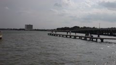 People fishing on pier at Clear Lake City Park. Stock Footage
