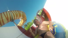 Fun on the water slide Stock Footage