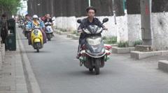 China motorbikes slow motion Stock Footage