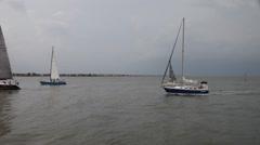 Sailboats returning to Kemah Marina. Stock Footage