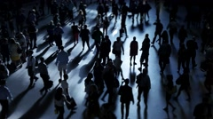 Silhouette shadow of business people walking on crowded city street Stock Footage
