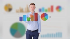 Young businessman analyzing financial growth on business charts Stock Footage