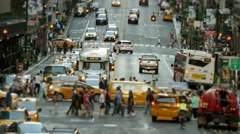 Traffic cars and pedestrians on busy street at rush hour in new york city Stock Footage