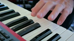 Piano playing music fingers sliding camera party playing Stock Footage