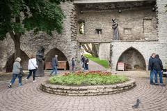 A mysterious monks, figures on the fortress wall in old Tallinn, Estonia Stock Photos