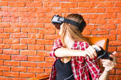technology, virtual reality, entertainment and people concept - woman with vr - stock photo