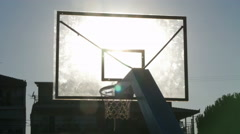 Basketball board with sunlight, close up, balls pass through the hoop with mesh. Stock Footage