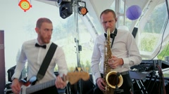 Music guitar playing at the party concert saxophone player white Stock Footage