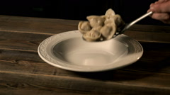 Chief Puts Boiled Bumplings In a Bowl. Ravioli Cooking Stock Footage