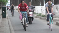 Chinese men on bikes slow motion Stock Footage
