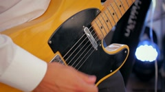 Music guitar playing hand yellow electric guitar fingers hand Stock Footage