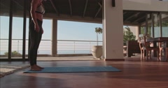 Young woman doing press ups at home Stock Footage
