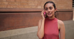 Young woman in city talking cell phone Stock Footage
