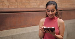 Young woman in city using tablet computer Stock Footage