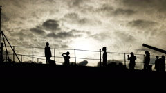 Silhouette Tourists on warship Museum and dark could motion Stock Footage