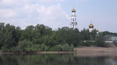 The Kama River shore. The Holy Theofany Monastery and a beach Stock Footage