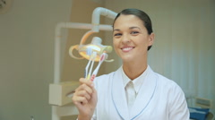Dentist doctor holding toothbrushes Stock Footage