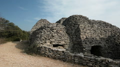 Dry stone huts in the village of Bories, Provence, France, pan Stock Footage