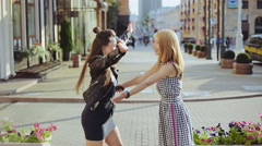 Happy meeting of two girls friends hugging in the street Stock Footage