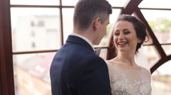 Bride smilling at the room near the window Stock Footage