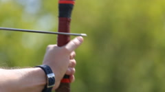 Men engaged in archery Stock Footage