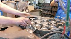 Glassworks. Glassware factory. Employee polishes glass Stock Footage