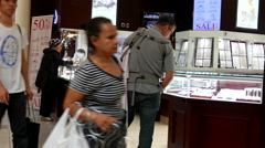 People shopping at Arctic Canadian Diamond jewelry store - stock footage