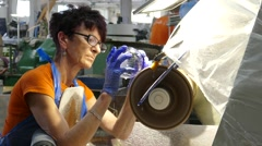Glassworks. Glassware factory. Employee is grinding pattern Stock Footage