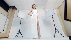 Beautiful girl posing for a photograph - backstage of photosession Stock Footage