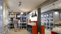 Glassware shop. People watching glass ware - stock footage