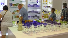 Glassware shop. People watching glass ware Stock Footage
