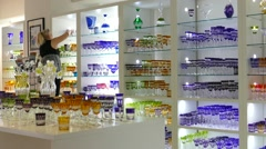 Glassware shop. Seller woman is cleaning shelfs Stock Footage