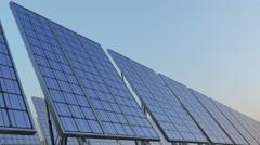 Row of modern solar panels against blue sky. Renewable solar energy generation Stock Footage