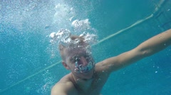 Man Swimming Under Water in Pool with GoPro. Slow Motion. Stock Footage